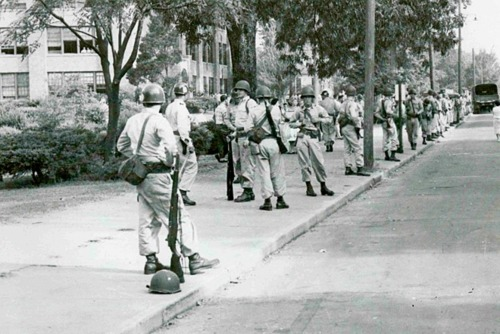 September 2, 1957. Ignoring a federal court order, Democrat Governor Orval Faubus orders national guardsmen to surround Little Rock's Central High School to prevent Negro students from attending classes.