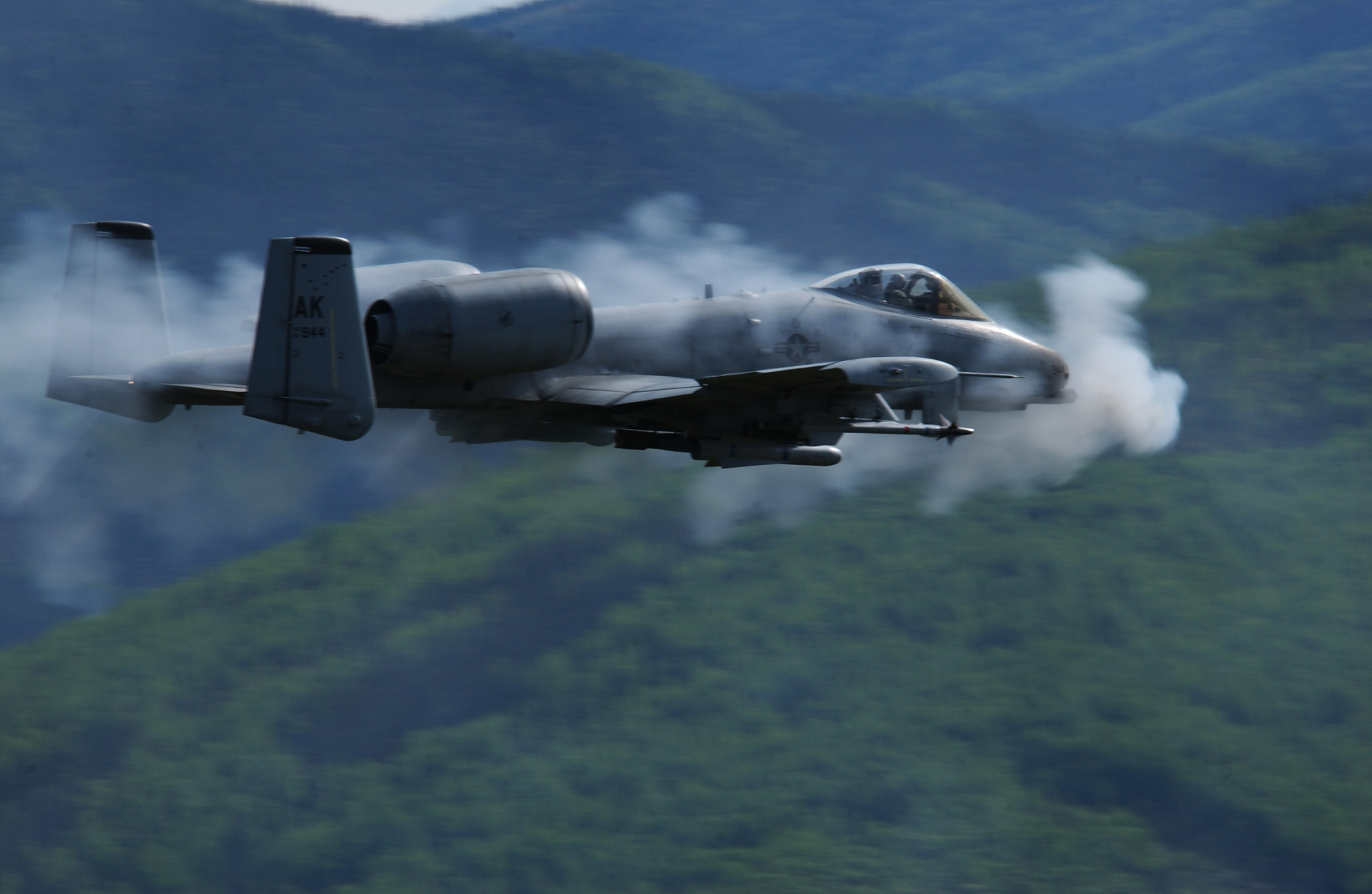 A U.S. Air Force A/OA-10 Thunderbolt II from the 355th Fighter Squadron is surrounded by a cloud of gun smoke as it fires a 30mm GAU-8 Avenger Gatling gun over the Pacific Alaska Range Complex in Alaska on May 29, 2007.  The seven-barrel Gatling gun can  be fired at a rate of 3,900 rounds per minute.  DoD photo by Airman 1st Class Jonathan Snyder, U.S. Air Force.  (Released)